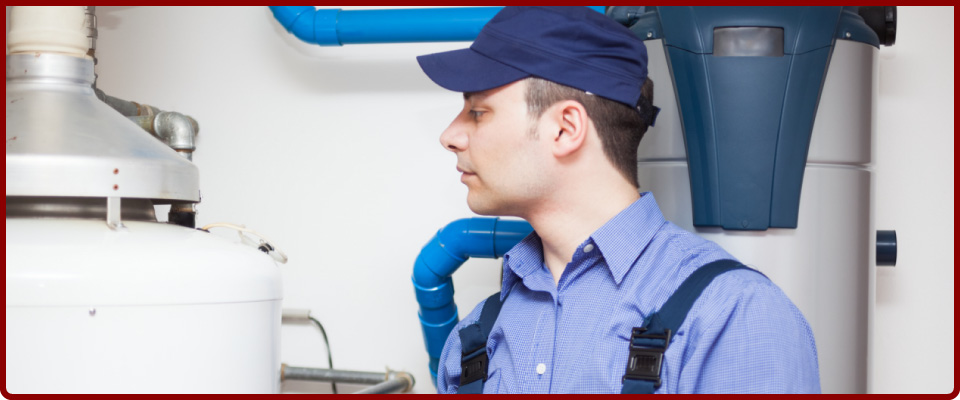 Man services water heater